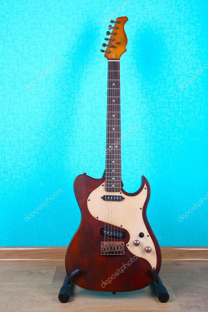 Blue Guitar Wallpaper Hd Electric Guitar On Blue Wallpaper Background Stock Photo C Belchonock 82108200