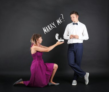 Romantic woman proposing to a man