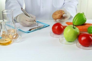 Scientist examines vegetables