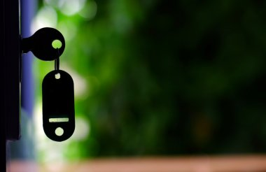 Key in door lock, summer defocus background