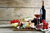 Still life with various types of Italian food and wine