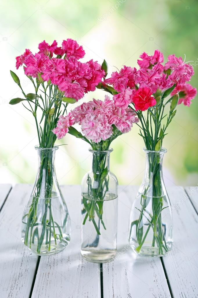 Beautiful Bouquet Of Pink Carnation In Vases Stock Photo