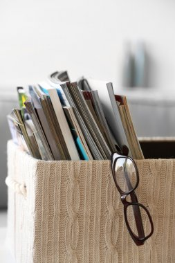 Magazines in basket in living room