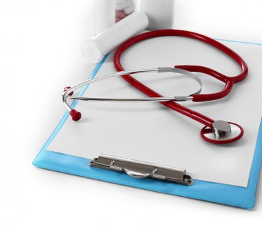 Medical stethoscope with clipboard and pills