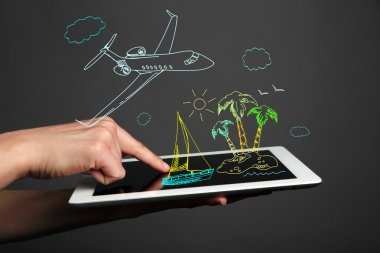 planning vacation on tablet  pc