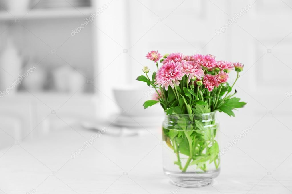 Beautiful Flowers In Vase On Table On Light Background Stock