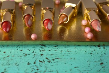 Make up lipsticks on tray closeup