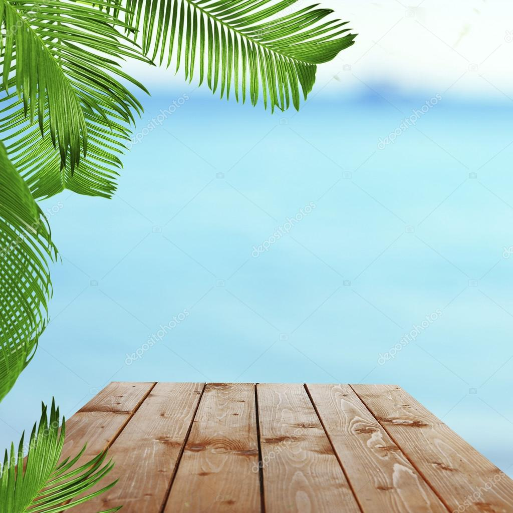 wooden table with tropical paradise background — stock photo