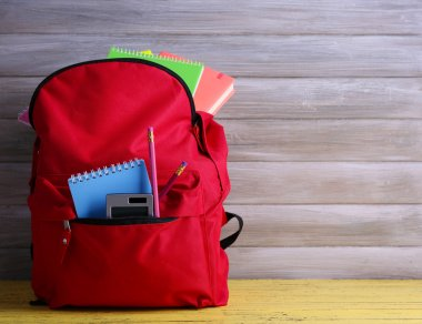 Red bag with school equipment
