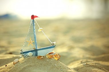 little yacht on the seashore
