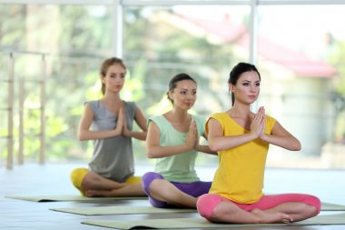 women meditating in yoga pose
