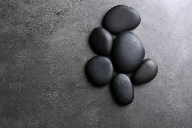 Group of pebbles on dark background