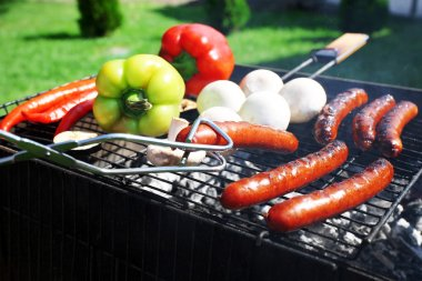 Sausages and vegetables on grill
