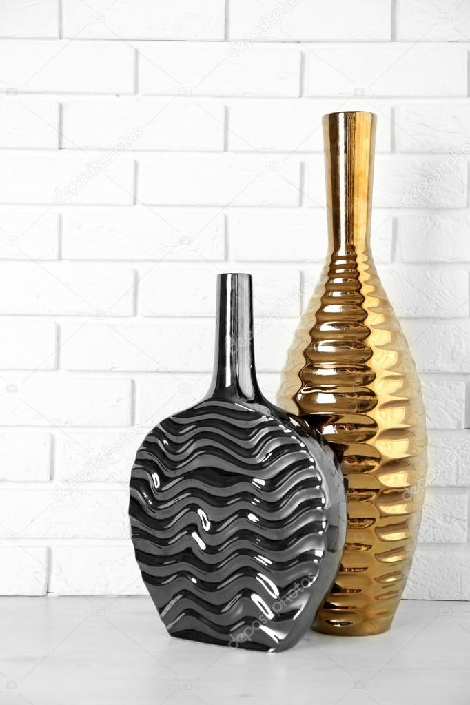 Beautiful Vases On Brick Wall Background Stock Photo Belchonock