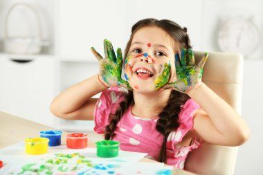 Cute little girl painting picture