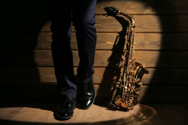 musician standing with sax