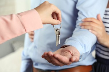 Real estate agent giving keys