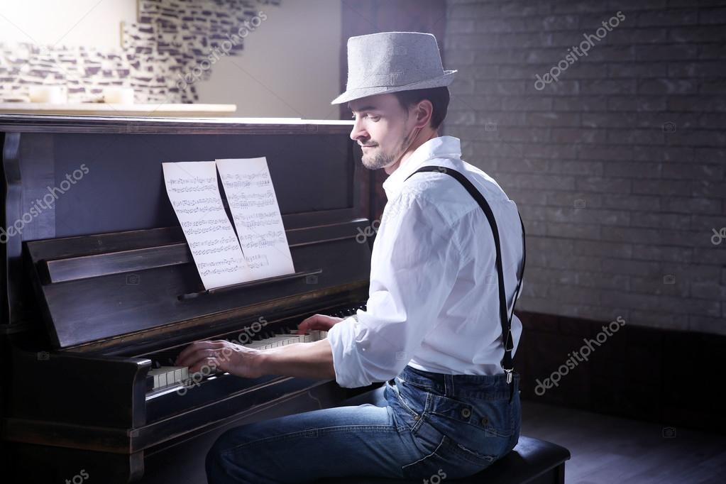Men playing piano with their penis