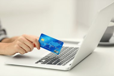 Female making online payment, close up