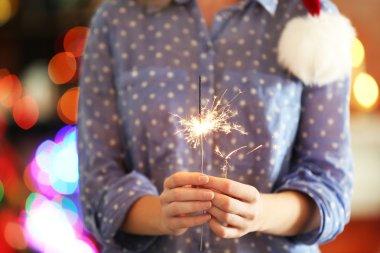 Female holding beautiful sparkler
