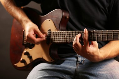 Young musician playing electric guitar