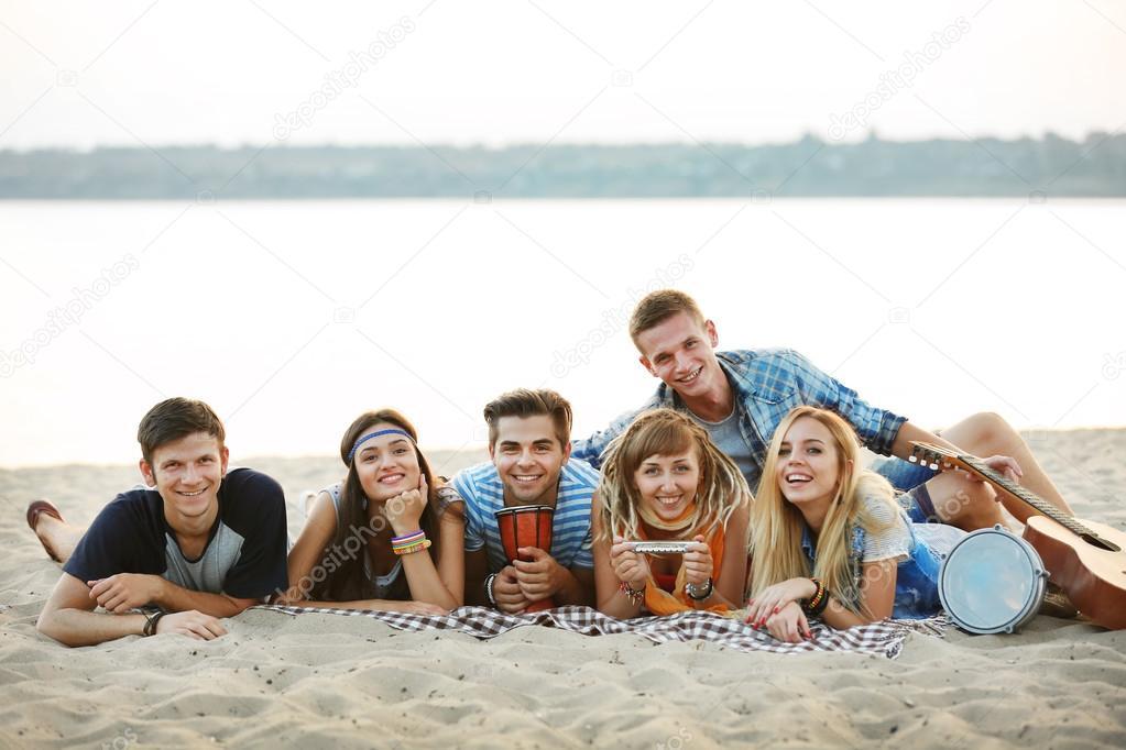 friends lying on beach