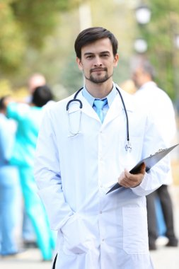 doctor holds clipboard