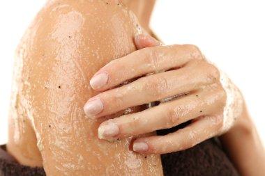 Woman using body scrub
