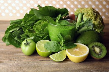 Green healthy juice with fruits and vegetables