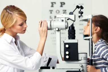 Female doctor examing girl patient