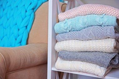 Hand made clothes on a shelf