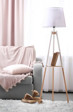 Comfortable sofa with lamp