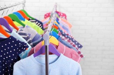 Children clothes on hangers