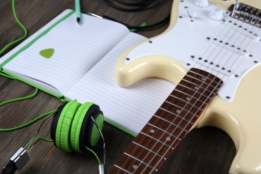 Electric guitar with green headphones