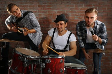 Musicians playing drums and guitar