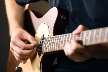 musician playing acoustic guitar