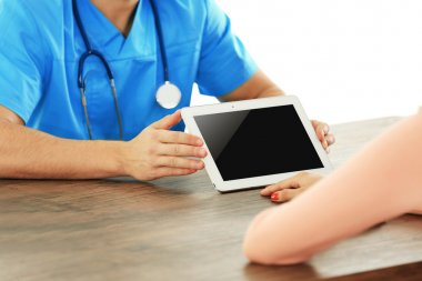 Male doctor with tablet
