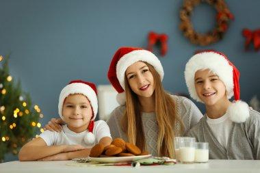 Happy children in Christmas room