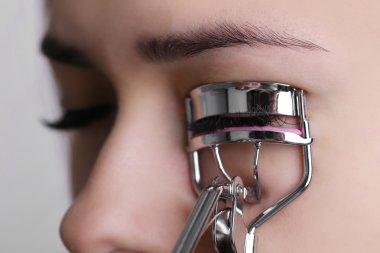 Woman corrects eyelashes