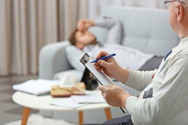 Man lying on sofa at psychologist