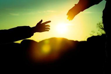 Man giving hand woman
