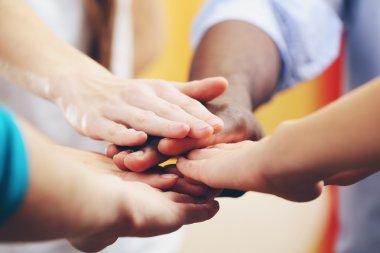 hands holding together, friendship concept