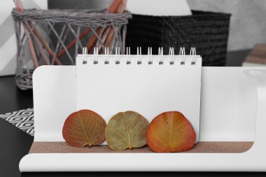 Notebook and dry leaves