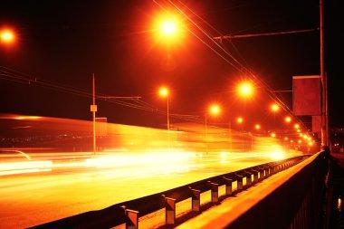 Freeway through bridge at night