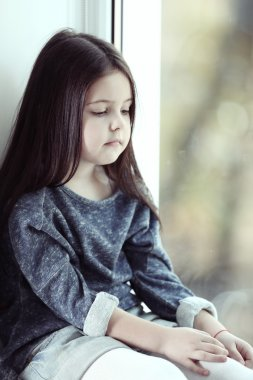 Little girl waiting for someone
