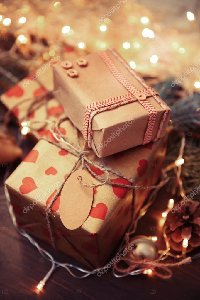Homemade wrapped Christmas gifts — Stock Photo © belchonock #98262660