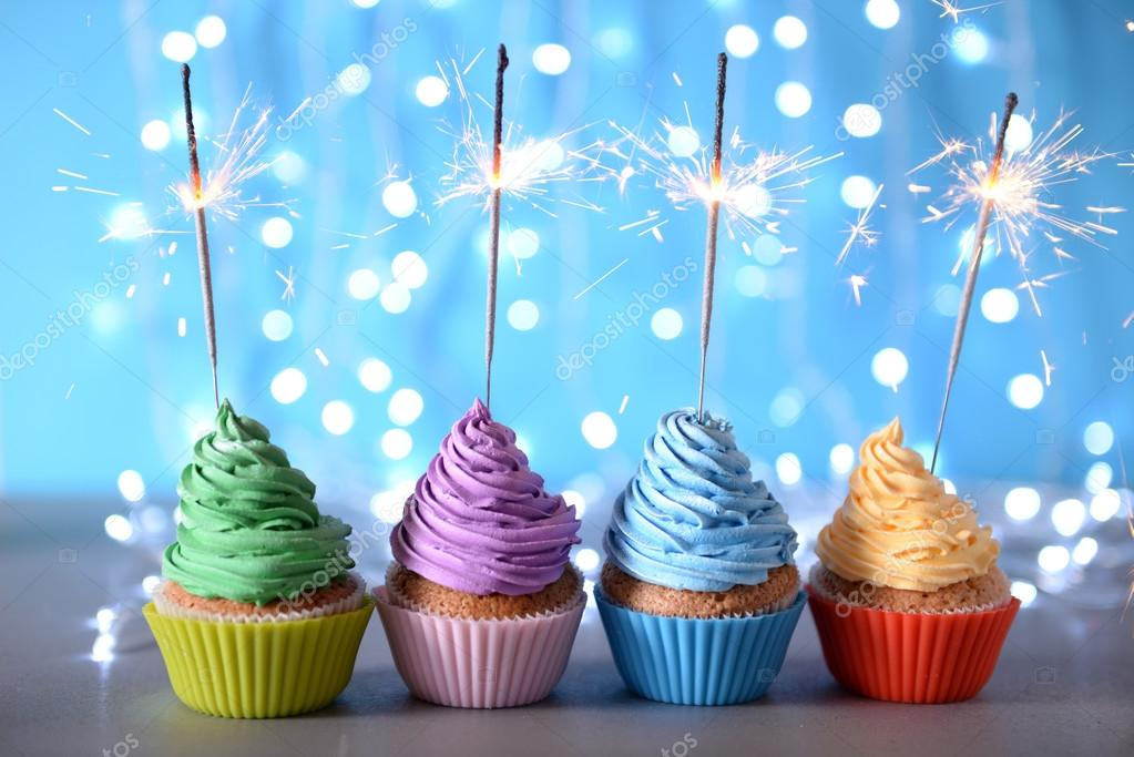Varicolored Cupcakes Icing With Sparklers In A Row On A
