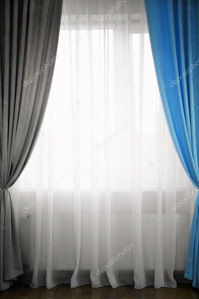 blauwe en grijze gordijnen stockfoto