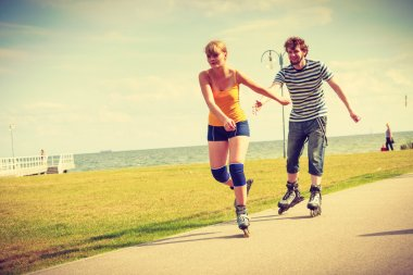 Young fit couple on roller skates