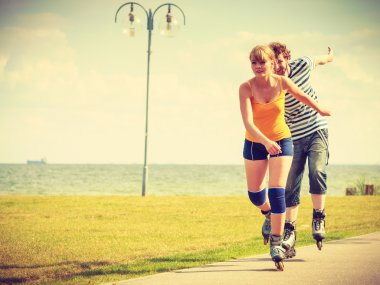 Young couple on roller skates